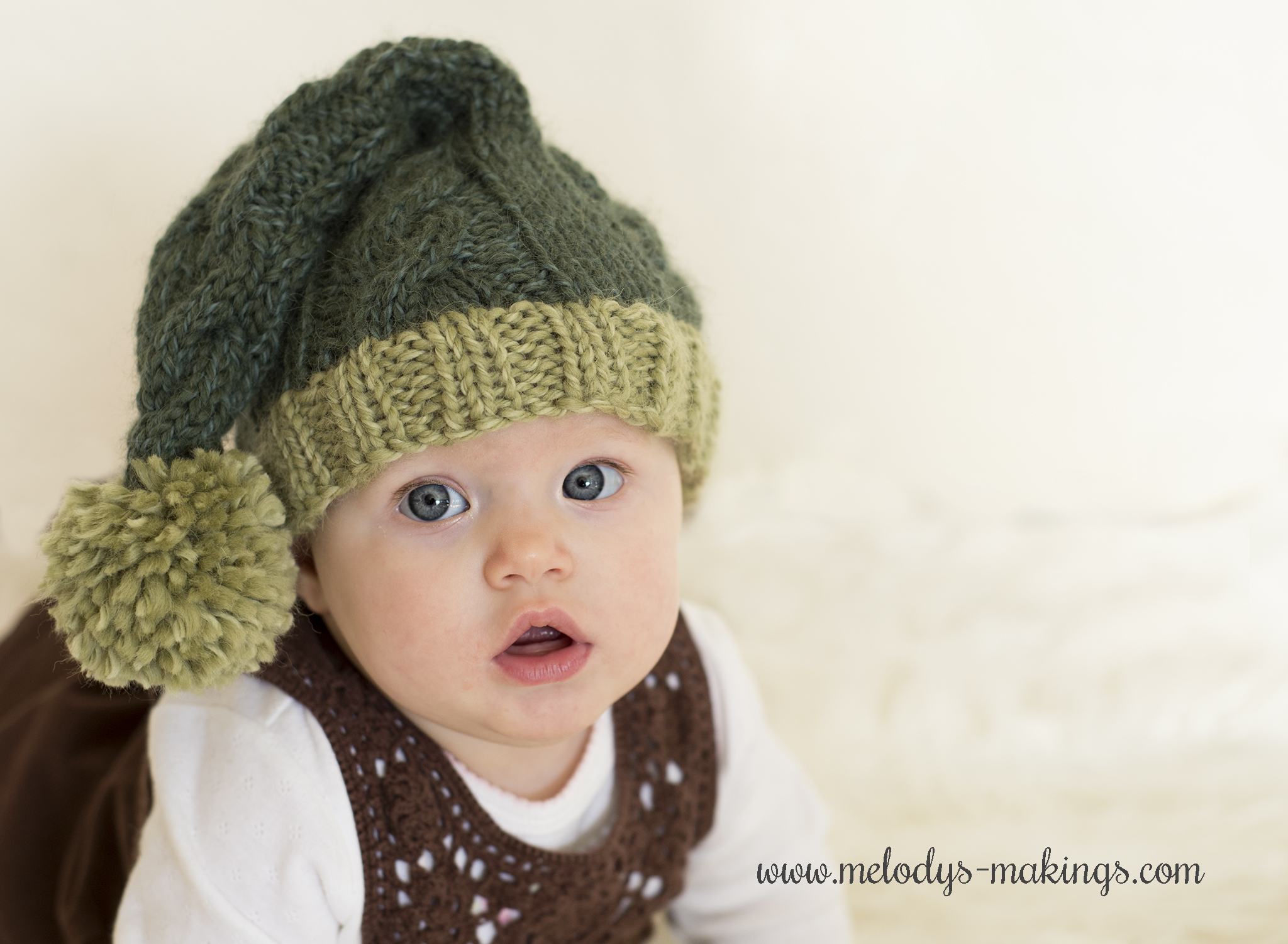 This cute free knit stocking cap pattern features a pretty cable running  from bottom to top 170185813d0